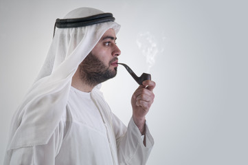 arabian business man smoking pipe