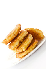 fried fritters on a white plate