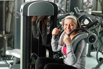 Fitness center senior woman exercise smiling