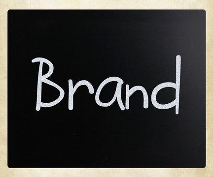 """""""Brand"""" handwritten with white chalk on a blackboard"""