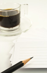 noteapd,pencil,black coffee on white background