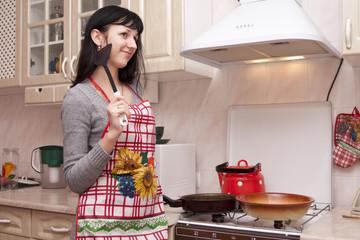 The woman prepares on kitchen