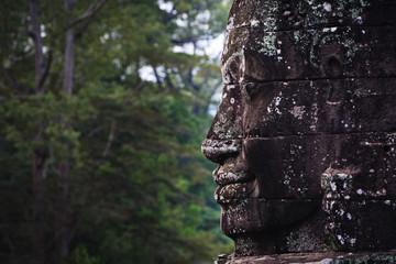 Stone face and jungle at Angkor Wat