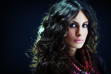 Portrait of a beautiful lady with long curly hair