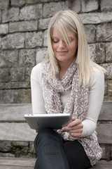young blond woman with tablet