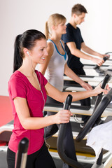 Young people on treadmill running exercise