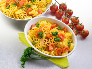 pasta with fresh tomatoes over steel background
