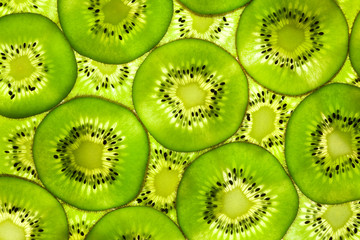 Zelfklevend Fotobehang Plakjes fruit Fresh Kiwi pattern / background / back lit