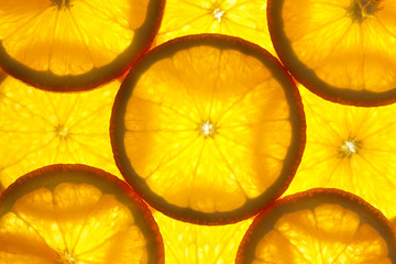 Zelfklevend Fotobehang Plakjes fruit Orange slices background / macro / back lit