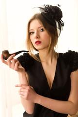 Retro woman portrait with smoking pipe