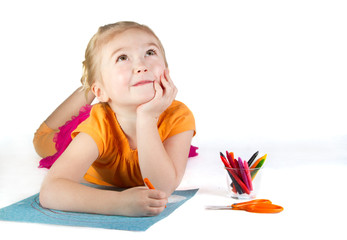 A girl drawing a rainbow, thinking