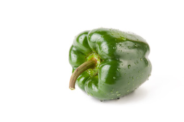 Close-up of green bell pepper, white background
