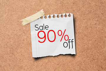 sale off price tag on wooden board.