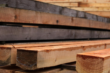 Timber stacked and the sawmill