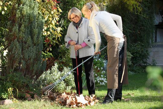 Elderly woman with her gardener