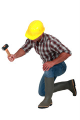 A construction worker with a hammer.