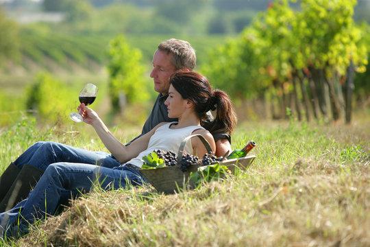 Couple tasting wine at a vineyard
