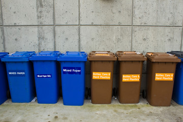 Row of Recycling and Garbage Cans
