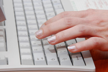 female hands typing computer keyboard