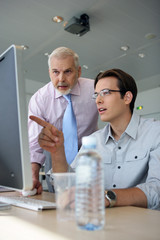 Young businessmen explaining point to boss