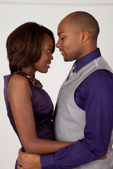 Black couple hugging romantically