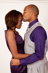 Black couple in relationship together, him kissing her