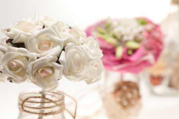 Bouquets and bottles on a white background