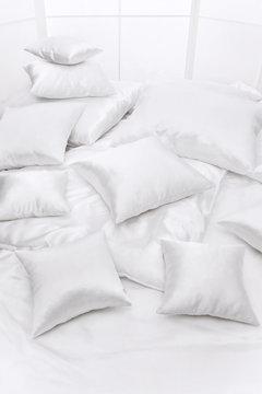 Heap of pillows at a window