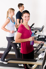 Young woman on fitness running belt
