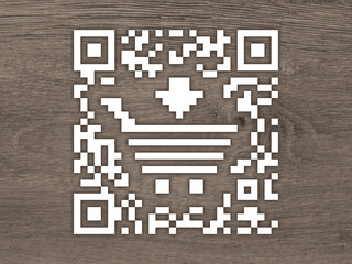 Concept QR code label with a shopping cart