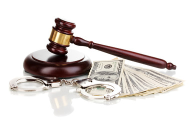 Dollar banknotes, handcuffs and judge's gavel isolated on white