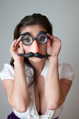 woman in play glasses with moustache