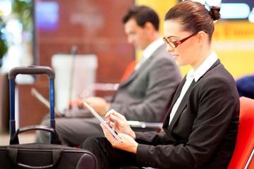 young businesswoman using tablet computer at airport