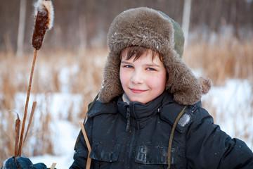Portrait of  boy wearing  hat, sedge, winter