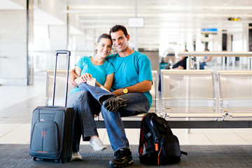 loving young couple waiting for flight at airport