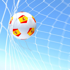 3d rendering of a spain flag on soccer ball in a net