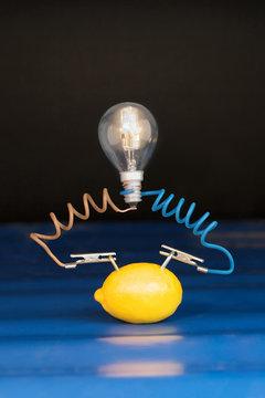 lemon and lamp on black background