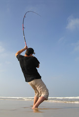 Tuinposter Vissen surf fishing, fishing fight