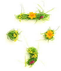 Symbols made of flowers and grass