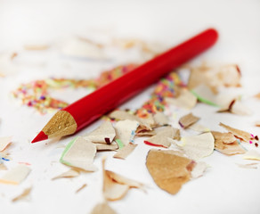 Sharp red pencil among pencils shavings