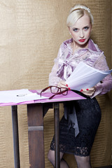 Strict blonde with an adult business transactions poses in the i