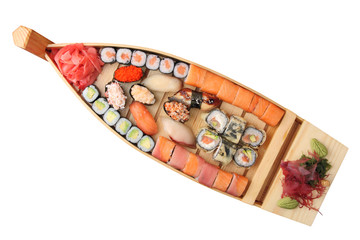 wooden ship with rolls and sushi