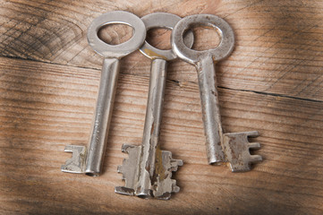 the old keys on a wooden background