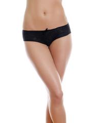 Belly and legs of beautiful woman in black panties.
