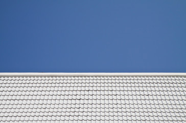 White roof on blue sky background.