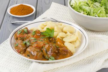Goulash - Hungarian sausage stew with homemade nokedli & salad