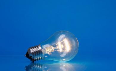 A light bulb, isolated on blue