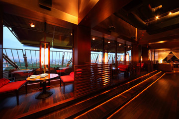 Row of tables and seats with partition-walls in restaurant