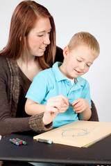 Mother and son drawing and coloring together
