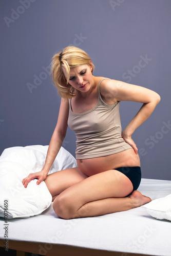 Болит спина при беременности 37 неделя